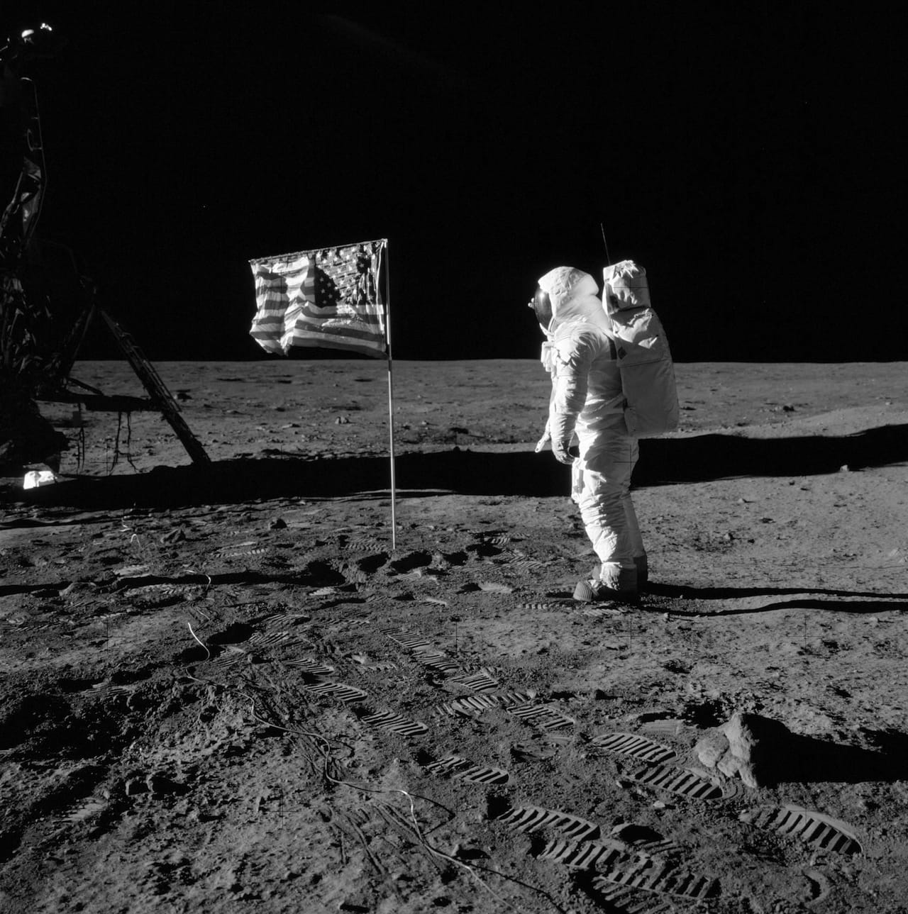 Buzz Aldrin salutes the flag on the Moon's surface, Apollo 11 mission time: 110:10:33. (Aldrin's fingertips can be seen on the far side of his helmet.) Image AS11-40-5874, courtesy NASA