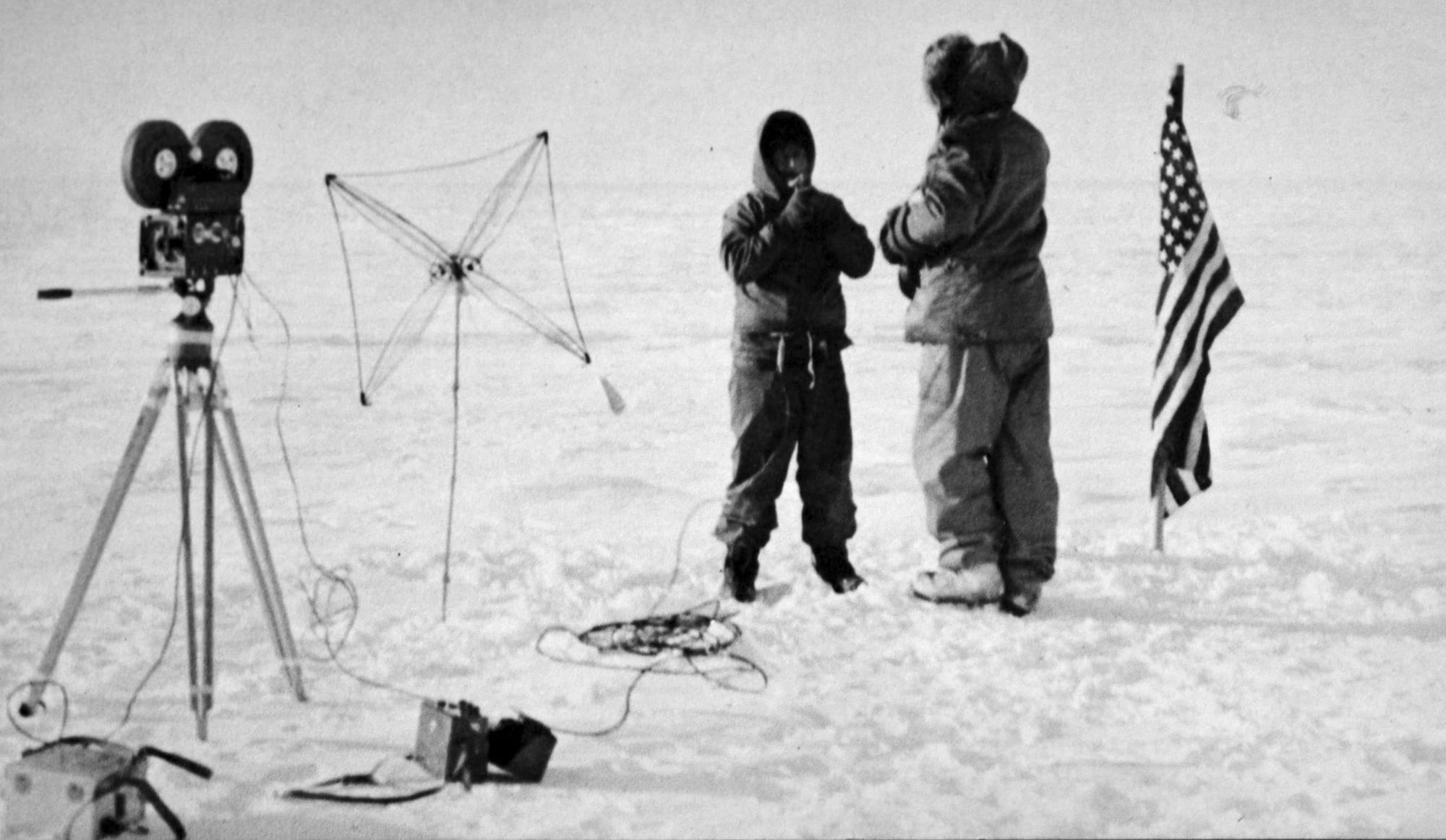 "Commander William ""Trigger"" Hawkes interviews Admiral George Dufek at the South Pole. © US Navy"